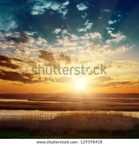 fantastic sunset over river #129598418