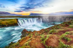Fantastic sunset scene of powerful Godafoss waterfall. Dramatic sky over Godafoss. Location: Bardardalur valley, Skjalfandafljot river, Iceland, Europe
