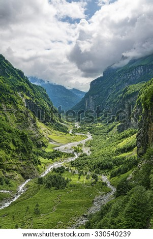 Fantastic view of green valley in canyon with river