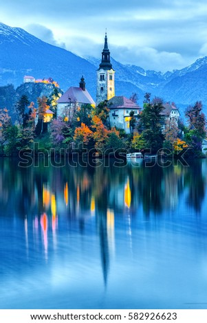 Fantastic view of night scenery at Bled lake with church on island . Dramatic , picturesque fall scene. Popular tourist attraction. Bled town, Slovenia, Europe. Artistic picture. Blue toning.