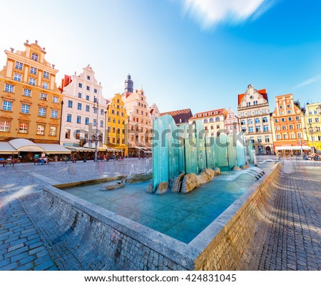 Fantastic view of the ancient homes on a sunny day. Gorgeous and picturesque scene. Location famous Market Square in Wroclaw, Poland, Europe. Historical capital of Silesia. Beauty world. Soft filter. #424831045