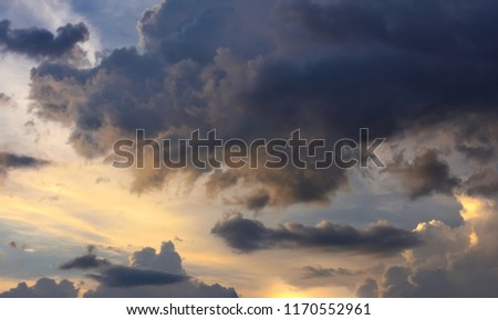 Fantastic view of the dark overcast sky. Picturesque sunset with thunderclouds