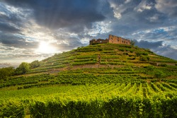 Fantastic view of the old castle ruins in Staufen im Breisgau in front of a dramatic sky
