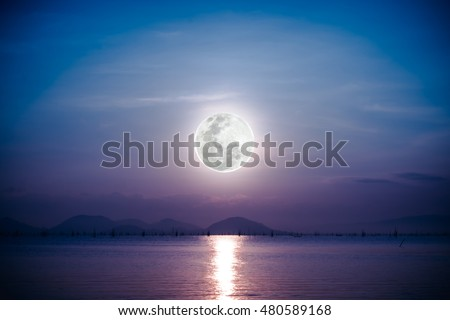 Fantastic view of the sea. Romantic scenic with full moon on sea to night. Reflection of moon in water. Vignette picture style. The moon were NOT furnished by NASA.