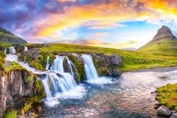 Fantastic view on Kirkjufellsfoss waterfall  near Kirkjufell mountain at sunset.  Location: Kirkjufellsfoss, Grundarfjordurn, Iceland, Europe