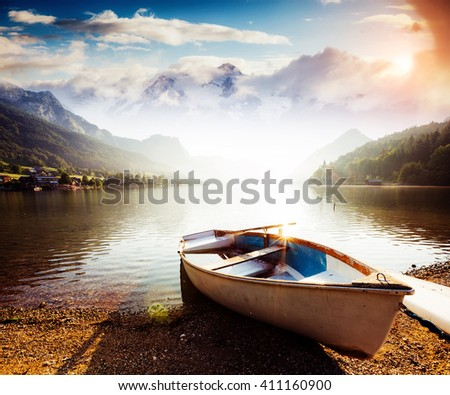 Fantastic views of the morning lake glowing by sunlight. Dramatic and picturesque scene. Location: resort Grundlsee, Liezen District of Styria, Austria, Alps. Europe. Beauty world. Instagram effect.
