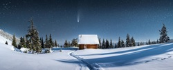 Fantastic winter landscape panorama with wooden house in snowy mountains. Starry sky with Milky Way and snow covered hut. Christmas holiday and winter vacations concept