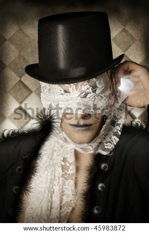 Fantastical stylized portrait of man in top hat and stylish fur coat with lace covering his face