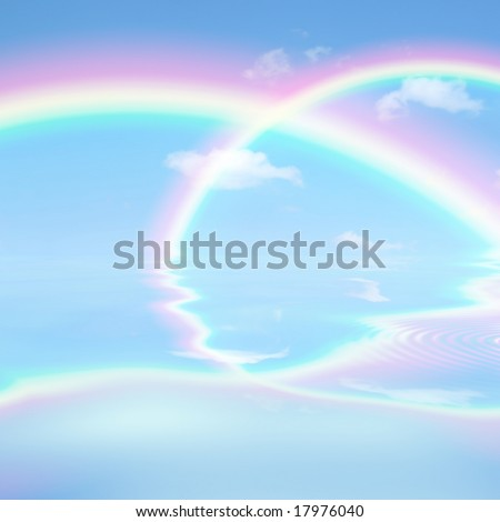 Fantasy abstract of  rainbows against a blue sky with reflection over rippled water.