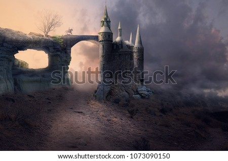 fantasy ancient castle with horse rider on a bridge