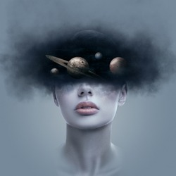 Fantasy art portrait of young woman with head in galaxy outer space. Concept of dreams or imagination