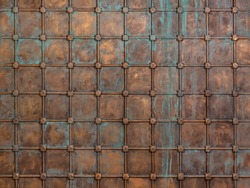Fantasy background: the surface is sheathed with copper sheets and reinforced with a lattice. Middle Ages, oxidized metal, knight's castle