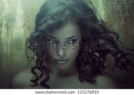 fantasy beauty portrait of a young dark skin woman in emerald tones