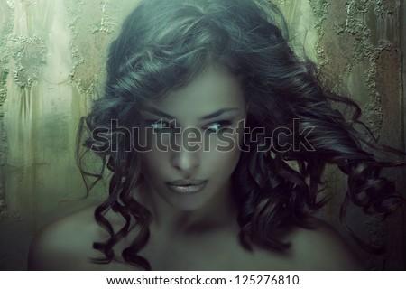 fantasy beauty portrait of a young dark skin woman in emerald tones