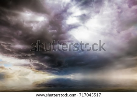 Stock Photo Fantasy cloudscape over water with UFO craft lights coming though the clouds.