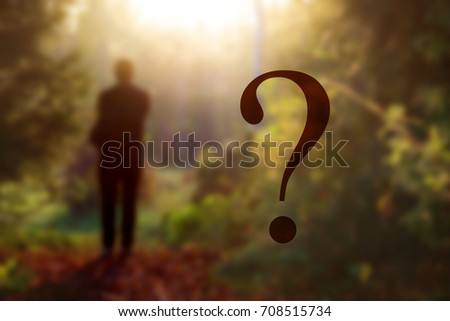 fantasy forest landscape. Mysterious surreal light in gloomy dark forest with fog between trees and man walking on natural path. mystery concept #708515734