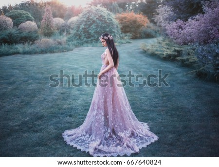 Fantasy girl in a fairy garden. Young elf in a beautiful purple dress with a long train. Creative colors artistic processing #667640824