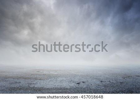 Fantasy gravel background with dramatic sky fog #457018648