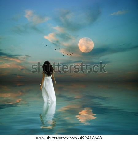 fantasy image of a beautiful women in the middle of the ocean during dawn