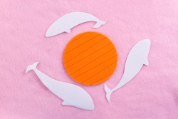 fantasy image paper whales on pink background