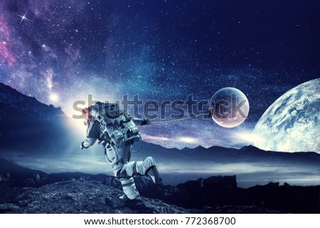 Fantasy image with spaceman catch planet. Mixed media #772368700