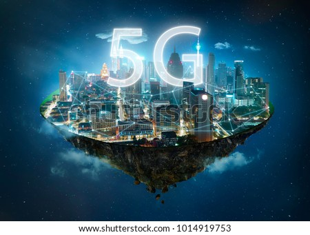 Fantasy island floating in the air with 5G network wireless systems and internet of things , Smart city and communication network concept . #1014919753