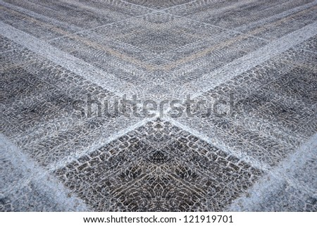 Fantasy pattern based on tyre prints in wet snow on asphalt, resembling a rug