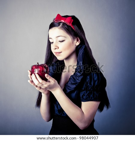fantasy portrait of the beautiful Snow White with an apple