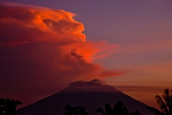 Fantasy shaped cloud over volcano in the sunset