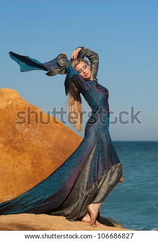 Stock Photo Fantasy style portrait of woman in blue dress