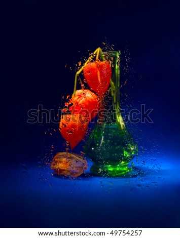 Fantasy with cape gooseberry and wet glass (still life)