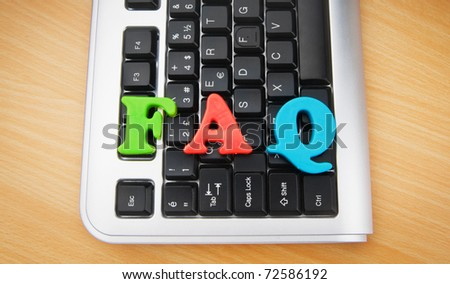 FAQ concept with letters on keyboard