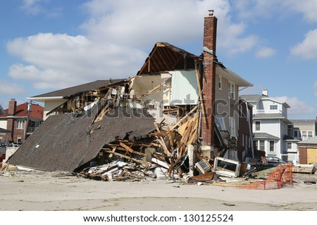 FAR ROCKAWAY, NY - FEBRUARY 28: Destroyed beach houses in devastated area four months after  Hurricane Sandy on February, 28, 2013 in Far Rockaway, NY