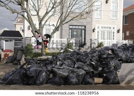 FAR ROCKAWAY, NY - NOVEMBER 4: Clean up started in the aftermath of Hurricane Sandy on November 4, 2012 in Far Rockaway, NY