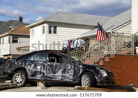 FAR ROCKAWAY, NY - NOVEMBER 4: Destroyed car in the aftermath of Hurricane Sandy on November 4, 2012 in Far Rockaway, NY