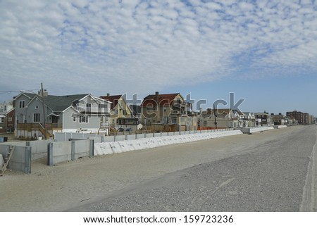 FAR ROCKAWAY, NY - OCTOBER 22: Protective barrier build to prevent damage in devastated residential area one year after Hurricane Sandy on October 22, 2013 in Far Rockaway, NY.