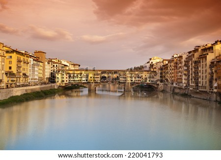 Far view at sunset of Ponte Vecchio in Florence, Italy. #220041793