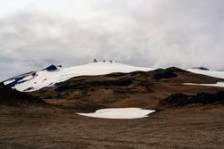 Far view of Snaefellsjökull volcano, its glacier, and the surroudings, located in the Snaefellsnes peninsula, western Iceland.  Photo taken during a road trip in summer 2009.