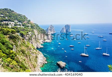 Faraglioni rocks visible from Giardini di Augusto in Capri, Italy. Focus on stone rocks