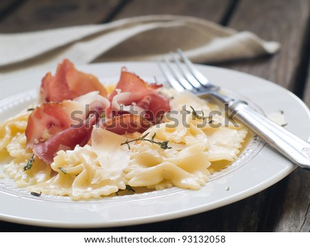 farfalle with prosciutto, cream sauce and thyme, selective focus