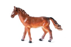 Farm animal. Beautiful toy rubber brown horse isolated on white background