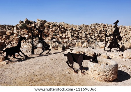 Farm animals and human statues in the Negev desert, En Avdat National Park, Israel
