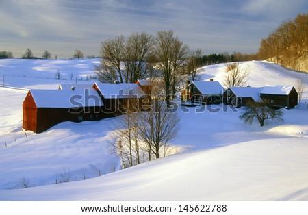 Farm at sunrise in winter snow, VT