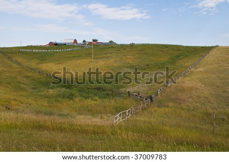 Farm at the top of a hill near Hayes, South Dakota - stock photo
