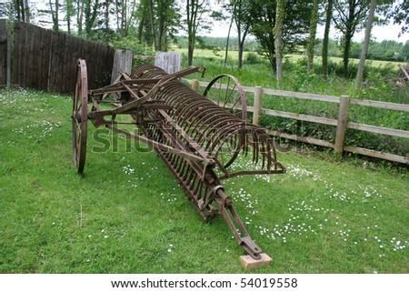 Farm equipment. Old case hay rake. - stock photo