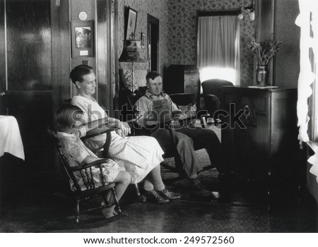 Farm family listening to their radio, Michigan, Aug. 15, 1930. Photo by George Ackerman.
