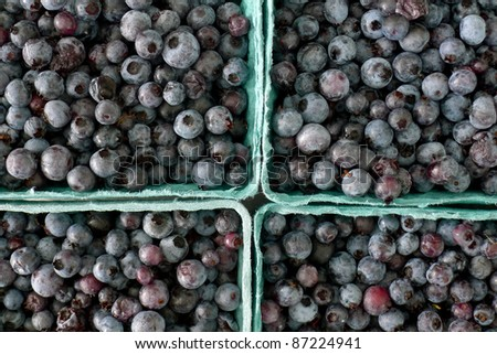 farm fresh hand picked blueberries in individual baskets for sale at a roadside farm market - stock photo