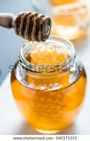farm fresh organic honey in rustic jar - Shutterstock ID 340375355