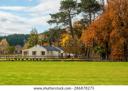 Farm house in rural Hawkes Bay, New Zealand, with autumn colour