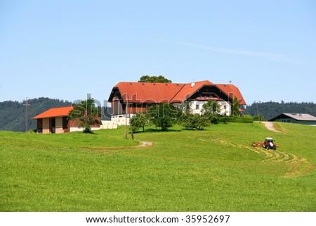 Farm in Salzkammergut, Austria. Green hills, beautiful pastures.